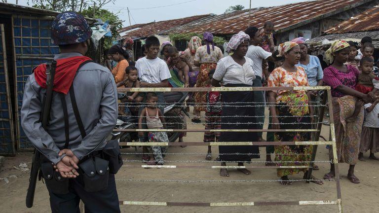 Police patrol the Thet Ke Pyin camp near Sittwe, Myanmar