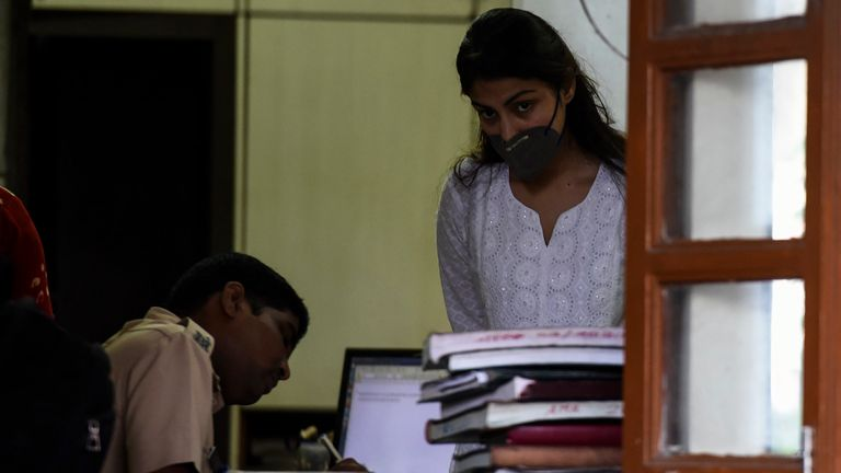 Bollywood actress Rhea Chakraborty looks out while waiting upon arriving at a police station for an enquiry a day after been granted bail, in Mumbai on October 8, 2020. - Bollywood actress Rhea Chakraborty won bail on October 7, nearly a month after being arrested for allegedly buying drugs for her ex-boyfriend actor Sushant Singh Rajput, whose suicide sparked a media storm in India