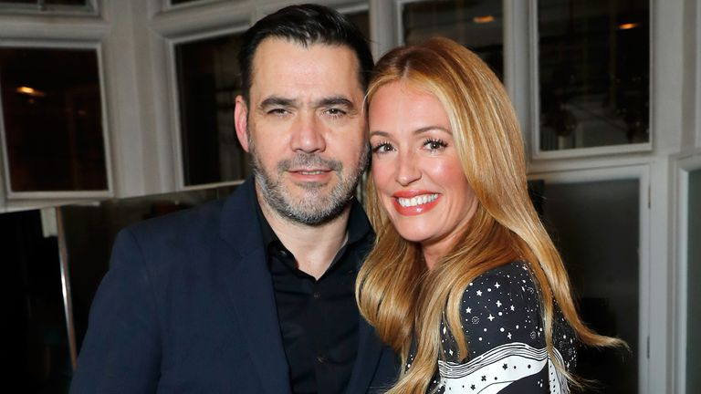 Roland Mouret is seen with TV host Cat Deeley at a fragrance launch