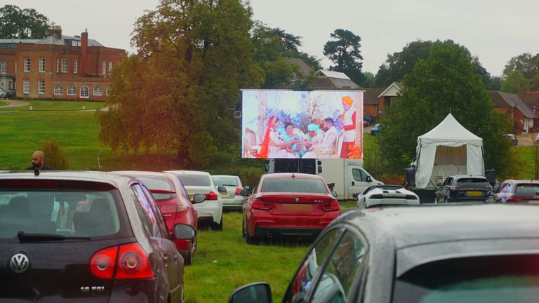 Guests watch Roma Popat and Vinal Patel's COVID-secure wedding at Braxted Park. Pic: Tim Stewart News /  I-MAANI PHOTOGRAPHY