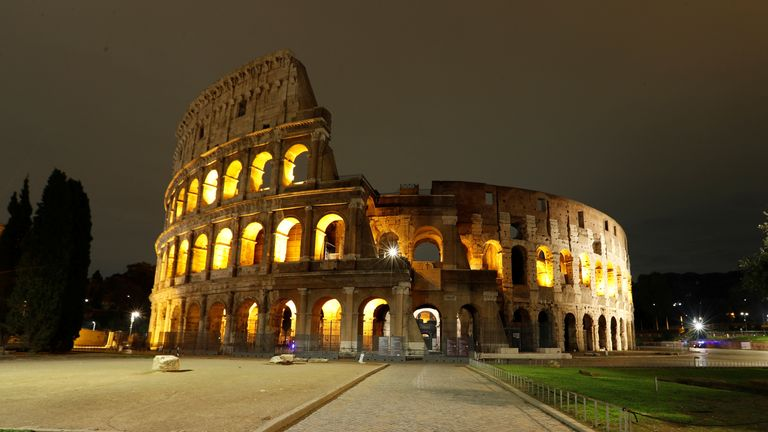 A deserted Colosseum is pictured as a curfew imposed by the region of Lazio from midnight to 5 a.m to curb the coronavirus disease (COVID-19) infections in Rome, Italy, October 24, 2020. REUTERS/Remo Casilli