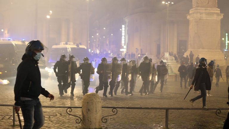 ROME, ITALY - OCTOBER 27: Police clashed with protesters in Rome who had gathered to denounce the latest set of restrictions introduced due to the coronavirus disease (COVID-19) pandemic on October 27, 2020 in Rome, Italy. Some 200 people gathered at Piazza del Popolo and began to throw firecrackers and smoke bombs at police after they were ordered to disperse. (Photo by Elisabetta A. Villa/Getty Images)