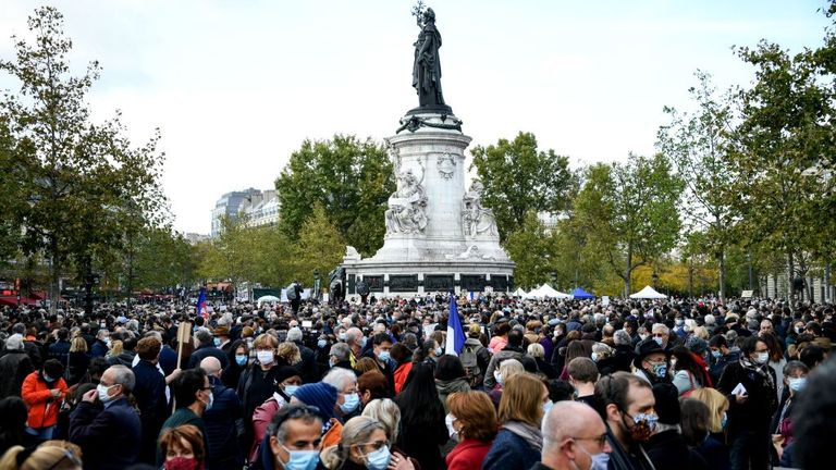 People gather on Place de la Republique in Paris on October 18, 2020, in homage to history teacher Samuel Paty two days after he was beheaded by an attacker who was shot dead by policemen