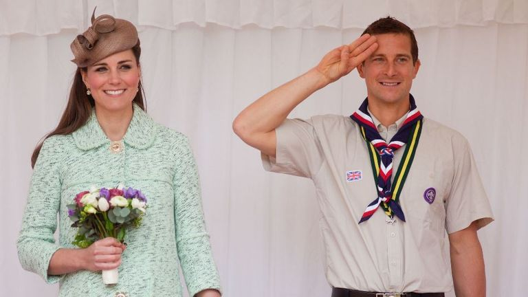 The Duchess of Cambridge stands with Chief Scout Bear Grylls