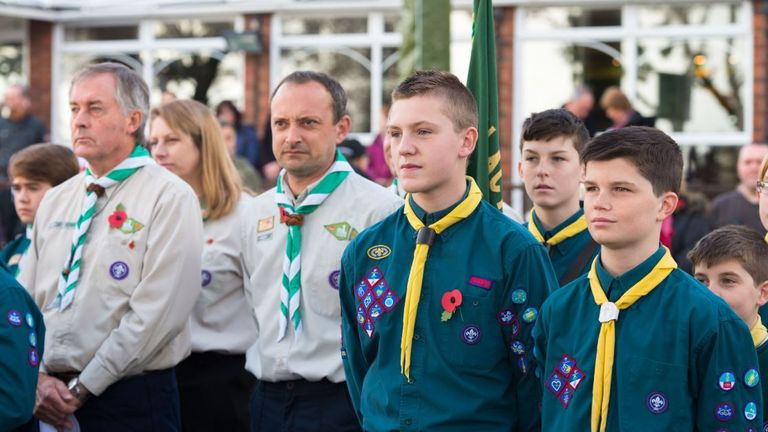 Scouts - young and older - standing together at a World War remembrance event
