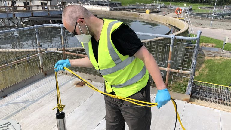 Taking a sample of raw wastewater at the wastewater treatment plant before  sewage testing for coronavirus