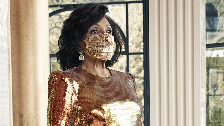 EMBARGOED TO 0001 FRIDAY OCTOBER 16 Undated handout photo of Dame Shirley Bassey, 83, wearing a matching face mask and sequined gold gown during a photo shoot in Italy for her forthcoming new album 'Owe It All To You'.