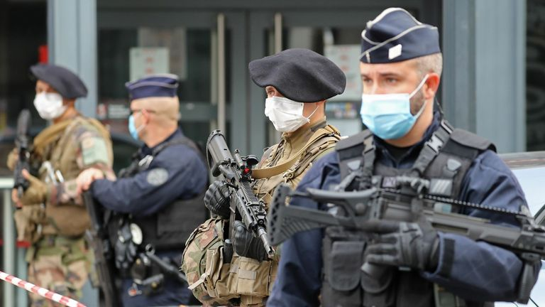 """French soldiers and policemen secure the site of a knife attack in Nice on October 29, 2020. - France's national anti-terror prosecutors said Thursday they have opened a murder inquiry after a man killed three people at a basilica in central Nice and wounded several others. The city's mayor, Christian Estrosi, told journalists at the scene that the assailant, detained shortly afterwards by police, """"kept repeating 'Allahu Akbar' (God is Greater) even while under medication."""" He added that Preside"""