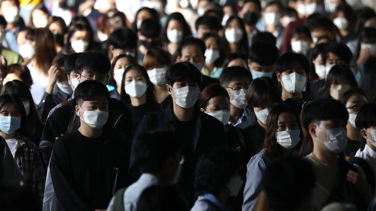 SEOUL, SOUTH KOREA - SEPTEMBER 15: South Korean commuters wear protective masks as they crowd after getting off the subway during rush hour on September 15, 2020 in Seoul, South Korea. South Korea decided relax business restrictions on eateries, fitness centers, franchise coffee chains and other facilities in the wider Seoul area, as the country decided Sunday to ease tougher anti-virus curbs in the region for the next two weeks.