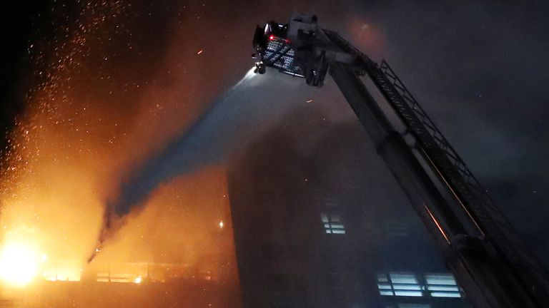 A water is sprayed to extinguish a fire at a mixed-use high-rise residential building in Ulsan, South Korea, October 9, 2020. Yonhap via REUTERS ATTENTION EDITORS - THIS IMAGE HAS BEEN SUPPLIED BY A THIRD PARTY. SOUTH KOREA OUT. NO RESALES. NO ARCHIVE.