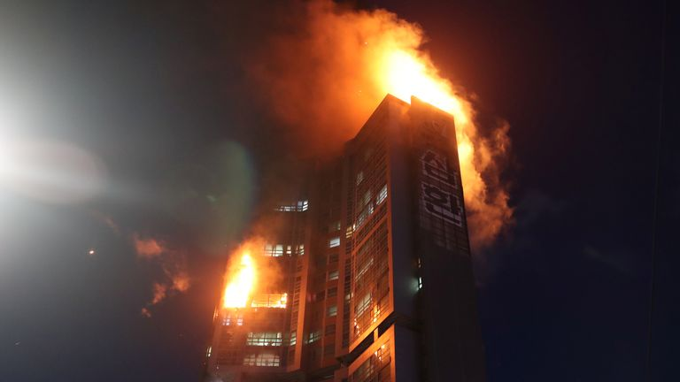 A mixed-use high-rise residential building is engulfed by a fire in Ulsan, South Korea, October 9, 2020. Yonhap via REUTERS ATTENTION EDITORS - THIS IMAGE HAS BEEN SUPPLIED BY A THIRD PARTY. SOUTH KOREA OUT. NO RESALES. NO ARCHIVE.