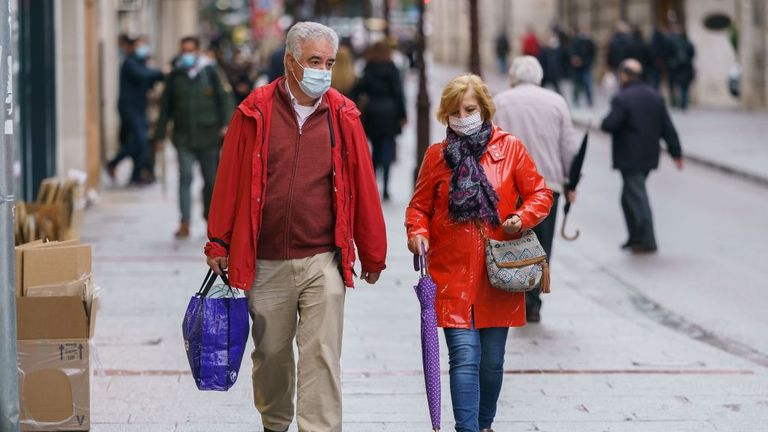 People wearing face masks walk in Burgos, northern Spain, on October 21, 2020, on the first day of a two week lockdown in an attempt to limit the contagion of the new coronavirus COVID-19 in the area. - Spain has become one of the pandemic's hotspots in the European Union, with close to 975,000 registered cases and nearly 34,000 deaths. (Photo by Cesar Manso / AFP) (Photo by CESAR MANSO/AFP via Getty Images)