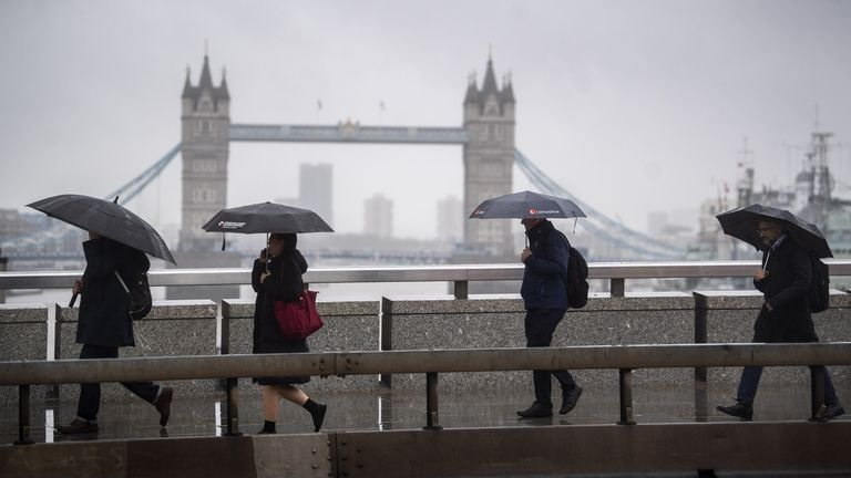 People in London as southern parts prepare for high winds and heavy rain