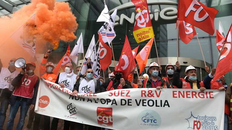 Unions members of Suez demonstrate against against Veolia's takeover bid on September 29, 2020 in La Defense, west of Paris, outside French energy firm Engie, parent company of Suez.