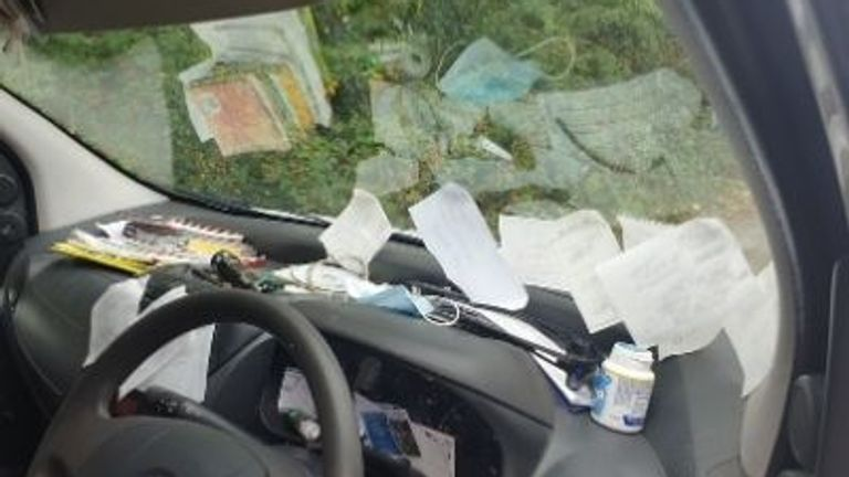 One driver was seen using their dashboard as a filing system. Pic: Surrey Police
