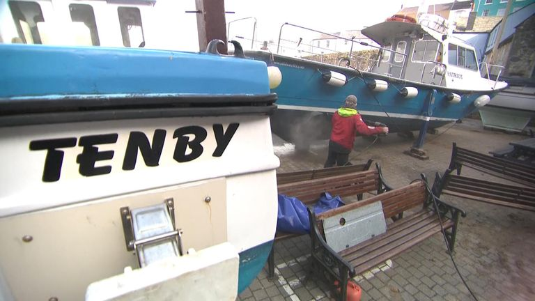 Boats being cleaned in Tenby Wales