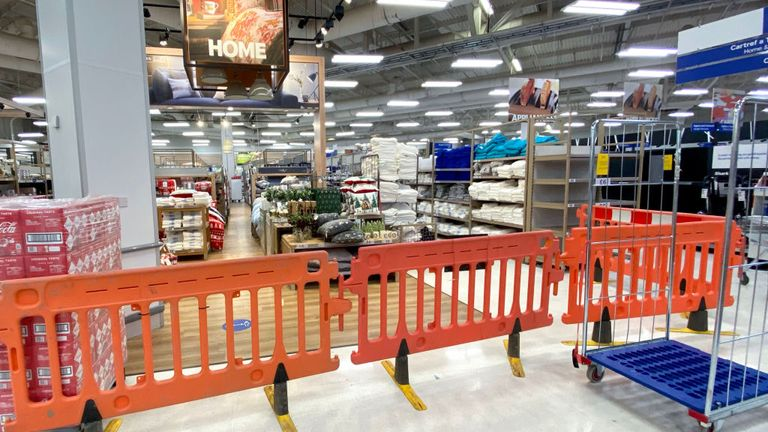 Home products are behind a plastic barrier at a Tesco in Cardiff