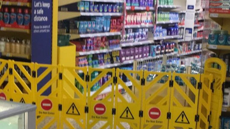 Sanitary products are blocked off in the non-essential section of a Welsh Tesco