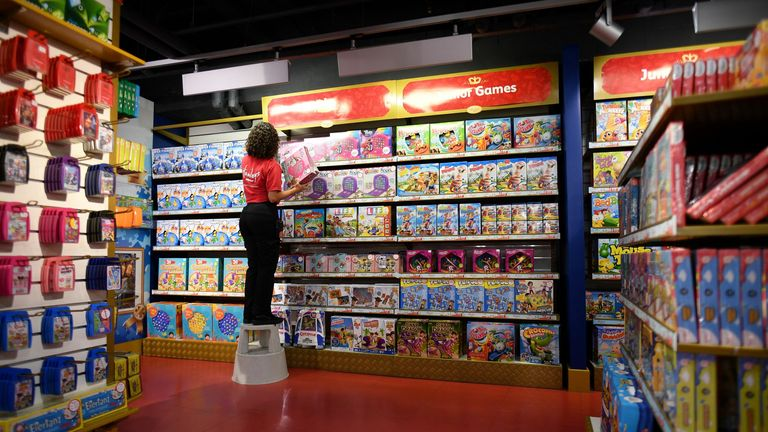 A shop assistant stacks toys on the shelves at the Hamleys toyshop in central London on October 15, 2020. (Photo by JUSTIN TALLIS / AFP) (Photo by JUSTIN TALLIS/AFP via Getty Images)
