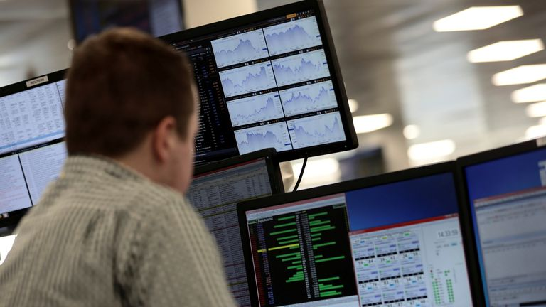 Traders looks at financial information on computer screens on the IG Index trading floor in London, Britain February 6, 2018.