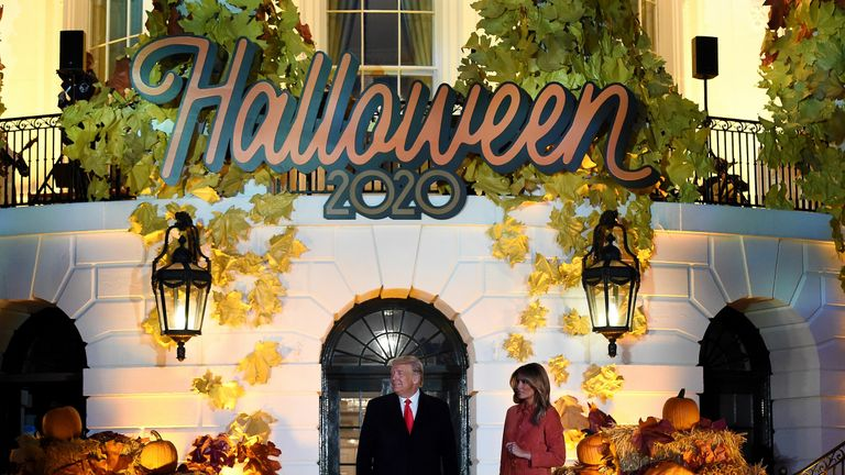 US President Donald Trump and First Lady Melania Trump pose during a Halloween celebration at the White House in Washington, DC, on October 25, 2020. - Due to Covid-19 the President and First Lady did not hand out actual candy to children, bags of goodies were set up on tables off to the sides of the event that families picked up individually. (Photo by Olivier DOULIERY / AFP) (Photo by OLIVIER DOULIERY/AFP via Getty Images)