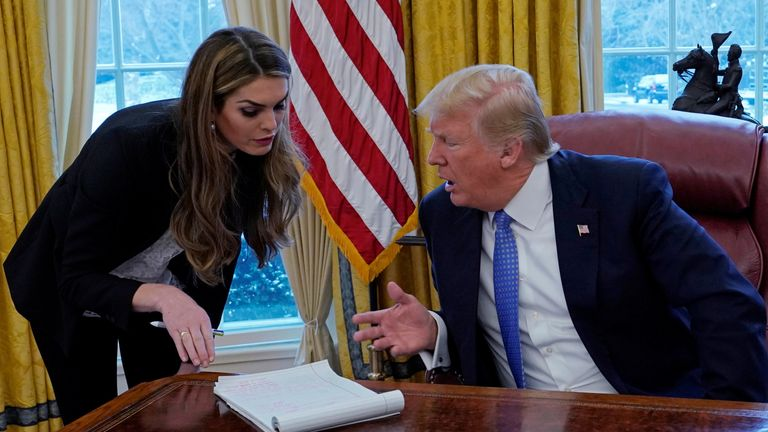 U.S. President Donald Trump confers with White House Communications Director Hope Hicks during an interview with Reuters at the White House in Washington, U.S., January 17, 2018