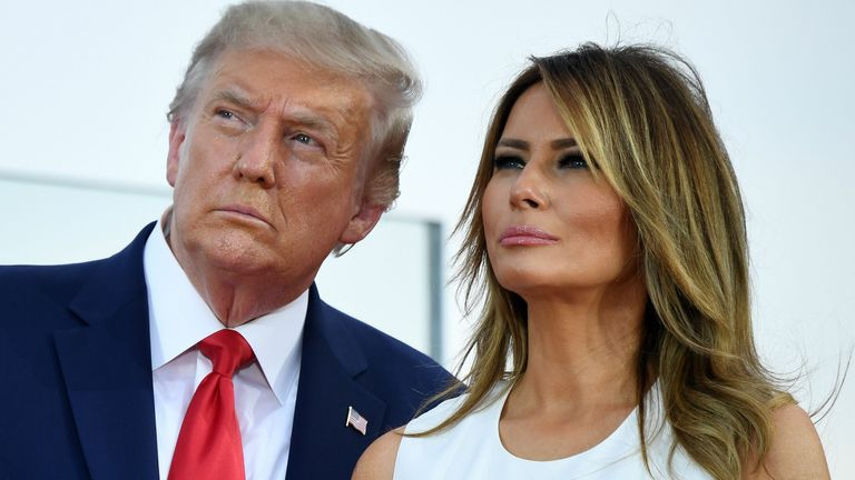 "US President Donald Trump and First Lady Melania Trump watch as planes flyover during the 2020 ""Salute to America"" event in honor of Independence Day on the South Lawn of the White House in Washington, DC, July 4, 2020. (Photo by SAUL LOEB / AFP) (Photo by SAUL LOEB/AFP via Getty Images)"