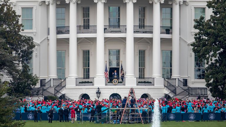 WASHINGTON, DC - OCTOBER 10: U.S. President Donald Trump delivers remarks from the White House balcony to a group of supporters on the South Lawn on October 10, 2020 in Washington, DC. The president is making his first in-person appearance after being cleared by his doctors following his diagnosis of COVID-19 on October 2. (Photo by Tasos Katopodis/Getty Images)