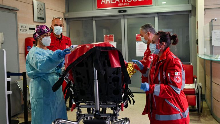 The staff of the red cross during the transport of a patient to the emergency room in the Mauriziano hospital on October 12, 2020 in Turin, Italy