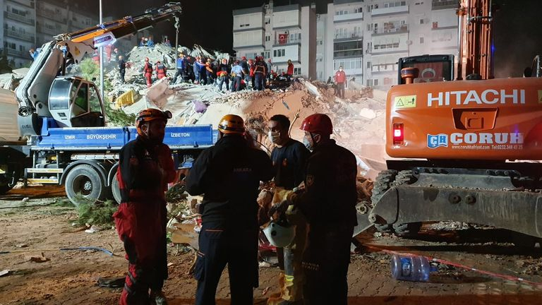 Rescue teams search through the rubble in Bayrakli, Izmir