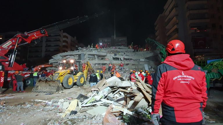 Locals watched as buildings collapsed in on themselves