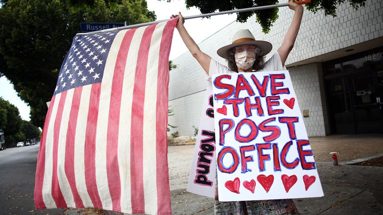The US Postal Service has faced funding cuts and has warned it may not be able to cope with the mail-in ballot demand