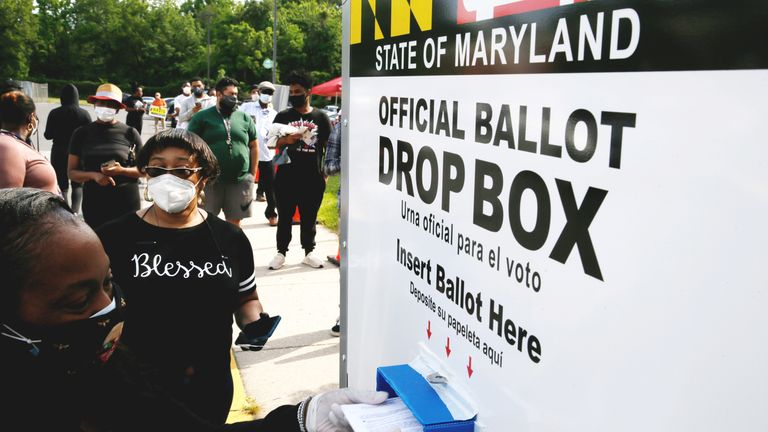 Voters in Maryland can place their ballots into a pavement drop box from their cars to prevent the spread of coronavirus