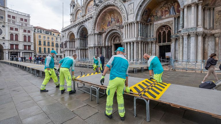 Raised walkways were installed in St Mark's Square ahead of the heavy rainfall