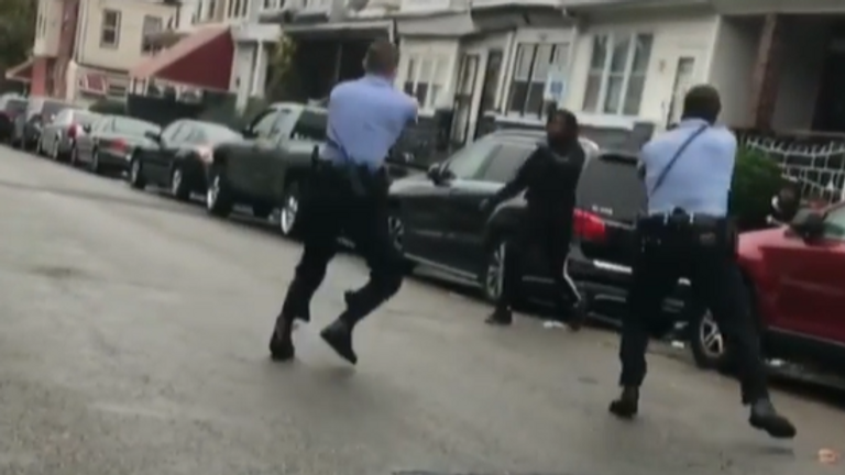 Footage shows police confronting a black man and firing several shots. Reports said the man was armed with a knife.