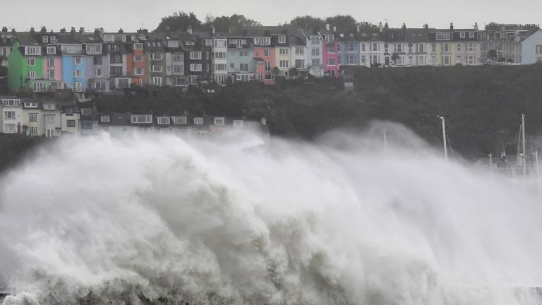 Large waves crash over the seawall as Storm Alex arrives in Brixham, Devon