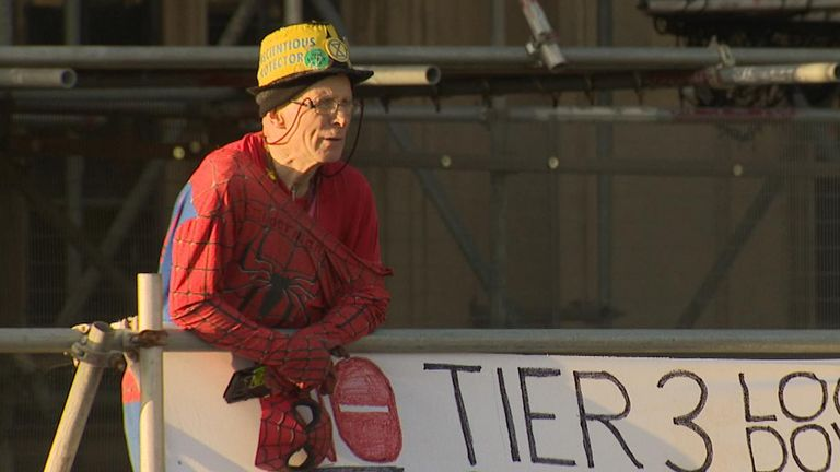 Protester on scaffolding outside parliament
