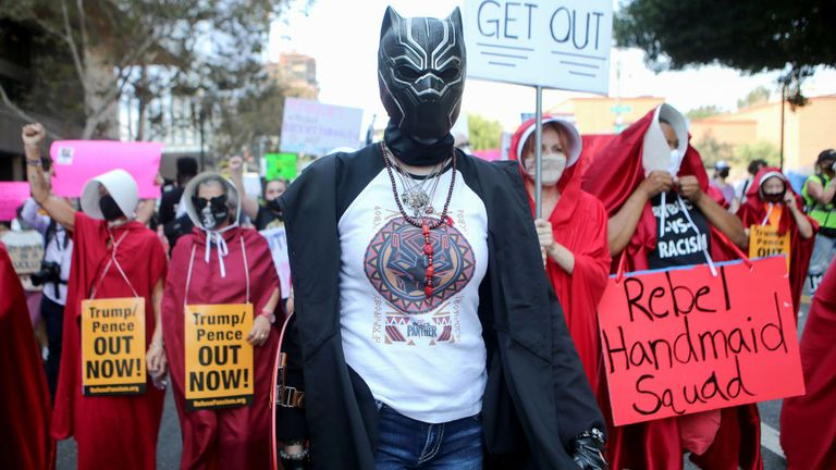 Protesters march during a Women's March advocating for women's rights on October 17, 2020 in Los Angeles, California