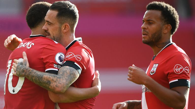 Che Adams celebrates with Danny Ings and Ryan Bertrand after doubling Southampton's lead against Everton