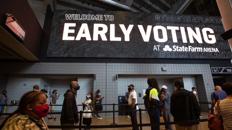 ATLANTA, GA - OCTOBER 12: Voters line up inside of State Farm Arena, Georgia's largest early voting location, for the first day of early voting in the General Election on October 12, 2020 in Atlanta, Georgia. Early voting in Georgia runs October 12-30. (Photo by Jessica McGowan/Getty Images)