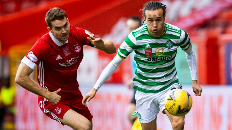 Celtic's Diego Laxalt and Tommie Hoban in action during a Scottish Premiership match between Aberdeen and Celtic at Pittodrie Stadium