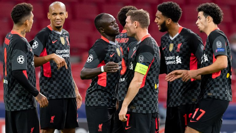 Liverpool players celebrate taking the lead at Ajax in their Champions League opener