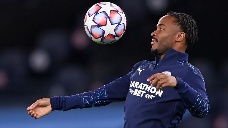 Raheem Sterling warms up for Manchester City ahead of their Champions League opener