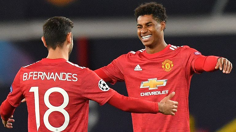 Marcus Rashford celebrates on his way to a hat-trick against RB Leipzig