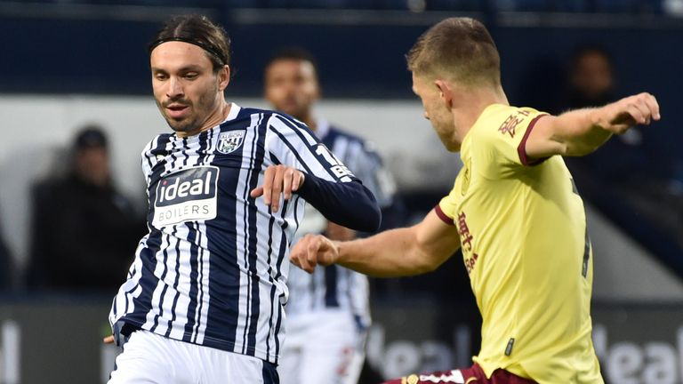 West Brom's Filip Krovinovic passes the ball under pressure from Johann Gudmundsson