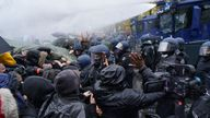 Water cannons were fired as riot police pushed back protesters