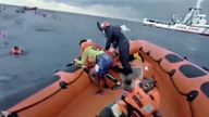 """""""I lost my baby, where's my baby?"""" screamed a desperate mother after being pulled from the water by rescuers as packed dinghy sank"""