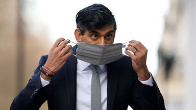 Britain's Chancellor of the Exchequer Rishi Sunak puts on a face covering due to the COVID-19 pandemic, as enters the BBC in central London on November 22, 2020, to take appear on the BBC political programme The Andrew Marr Show. - Britain's debt is now at its highest level since 1961 as a share of GDP, after the government embarked on a massive spending spree to mitigate the economic effects of the COVID-19 coronavirus pandemic and resulting lockdowns. (Photo by Tolga Akmen / AFP) (Photo by TOLGA AKMEN/AFP via Getty Images)