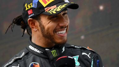 Button backs Hamilton to break record