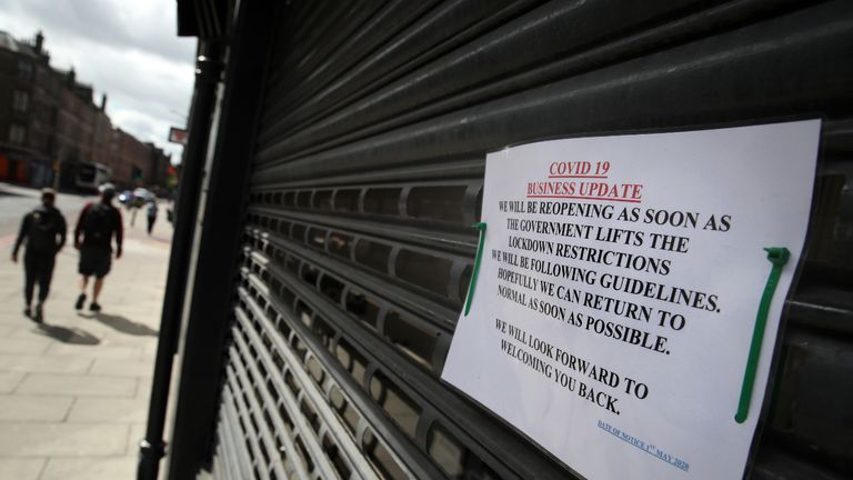 A sign on the shutters of a business premises in Edinburgh as the UK continues in lockdown to help curb the spread of the coronavirus.
